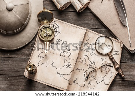 An old brass compass on  map background - stock photo