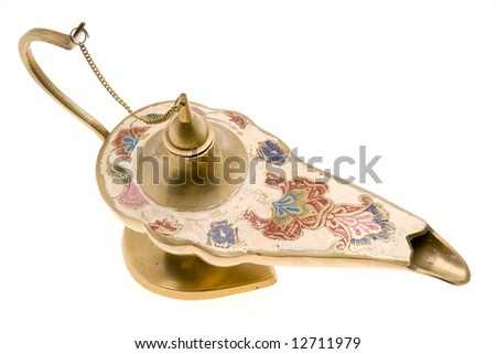 An old brass oil lamp on white background - stock photo