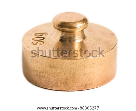 an old brass weight isolated on white background - stock photo