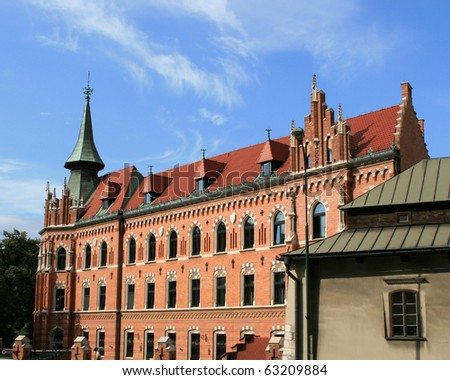 An old brick building in Cracow - stock photo