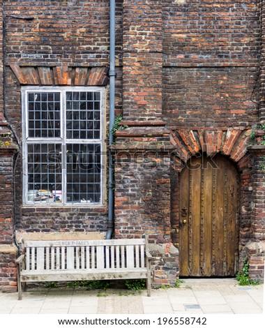An old brick house with black wooden door seen in Rye, Kent, UK - stock photo