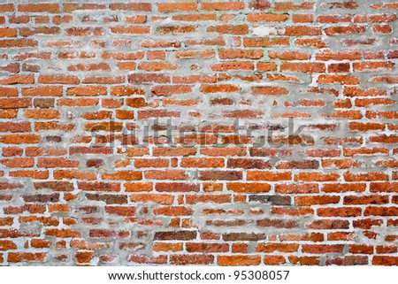 An old brick wall background - stock photo