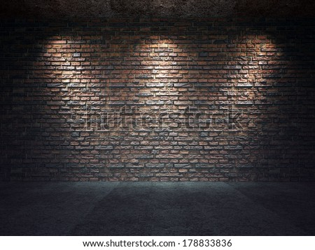 An old brick wall illuminated by three spot lights - stock photo