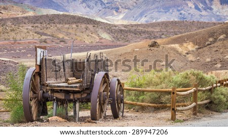 An old broken down wagon abandoned in the field - stock photo