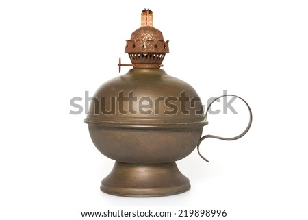 An old bronze oil lamp with wick isolated on a white background - stock photo