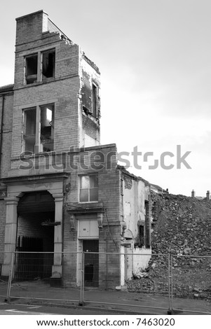 An old building cordoned off and in a state of demolition - stock photo