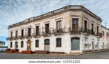 An old building in historic neighborhood in Colonia del Sacramento, Uruguay - stock photo