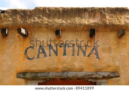 An old cantina in a traditional adobe building - stock photo