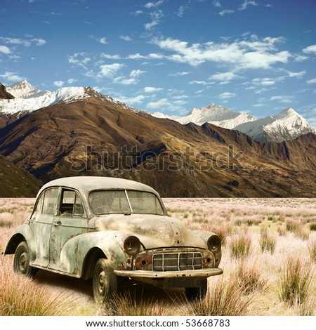 an old car in a mountain landscape