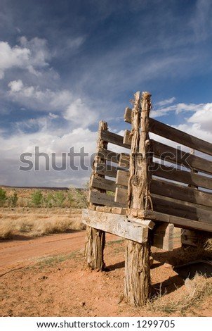 An old cattle chutestands against an amazing blue sky in America's beautiful desert near Escalante, Utah - stock photo