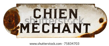 An old, chipped 'Beware of the Dog' sign in French - stock photo