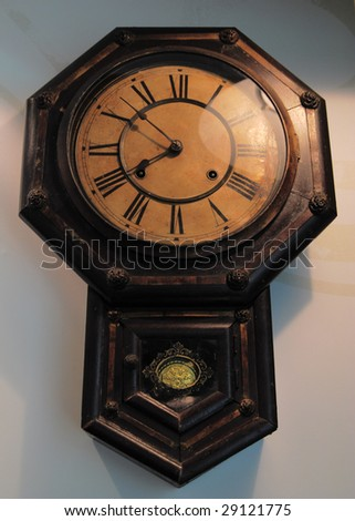 An old clock on the wall - stock photo