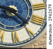 an old clock with bright colours - stock photo