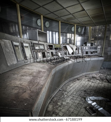 An old controle room of an abandoned power plant - stock photo