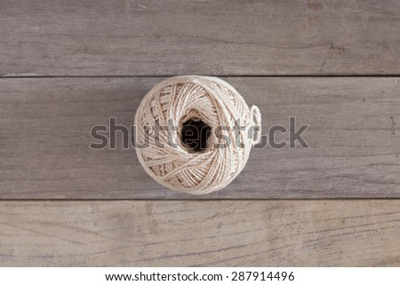 An old cord over a wooden table