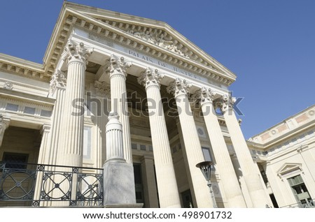an old courthouse with pillars, french justice building