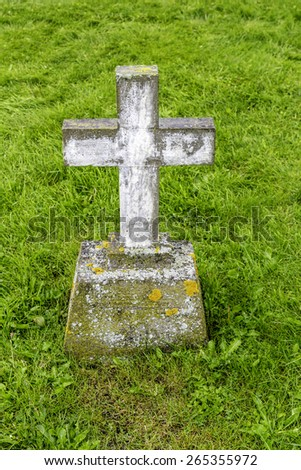 An old cross grave marker in rural Iceland - stock photo