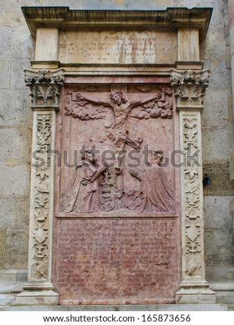 An old crucifixion relief sculpture outside St. Stephen's Cathedral in Vienna, Austria