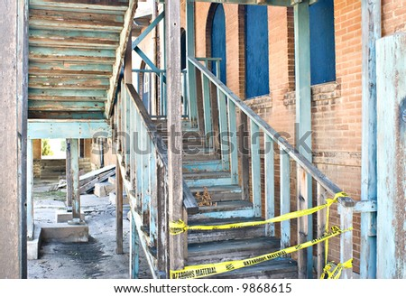 An Old Dangerous Staircase on the Side of an Abandoned Building - stock photo
