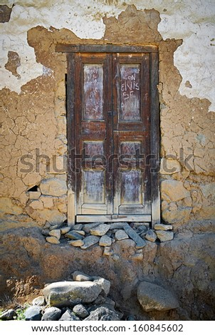 An old door on an adobe building in the Peruvian Andes, South America.