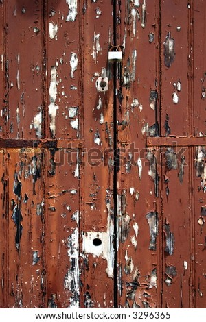 an old door with peeled painting - stock photo