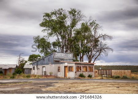 An old drive in motel and restaurant near the outskirts of Ephrata in the high desert of Eastern Washington has been boarded up and abandoned. - stock photo
