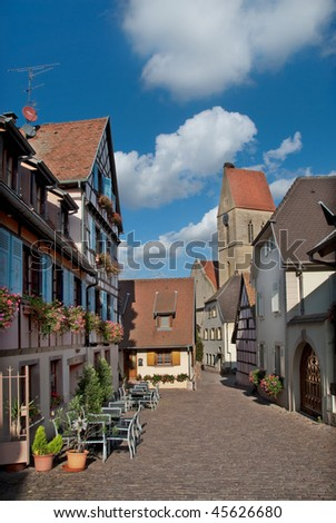 an old european street with houses  and paved street - stock photo