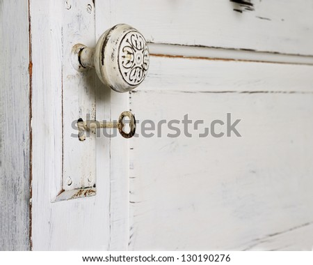 An Old Fashioned Door with a knob and Skeleton Key - stock photo