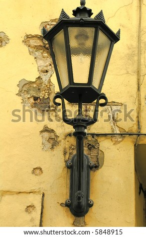 An old fashioned lantern on the grunge old wall