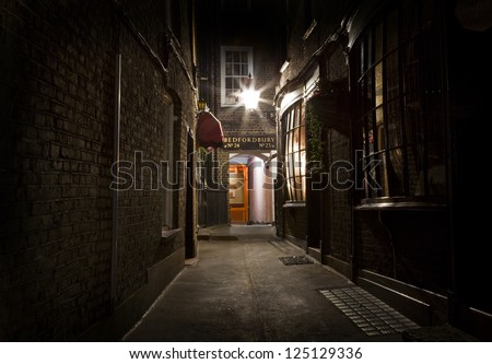 An old-fashioned London Alleyway in the city. - stock photo