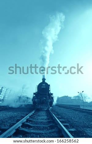 An Old Fashioned Steam Engine and Train.  - stock photo