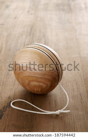 An old fashioned style wooden yoyo a retro childhood concept - stock photo