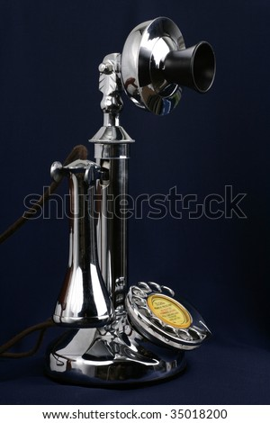 an old fashioned telephone - stock photo