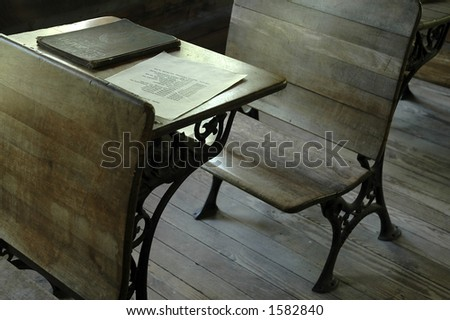 An old-fashioned wooden desk in a one-room school. - stock photo