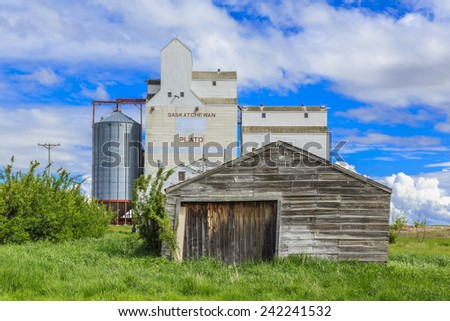 An old garage or shop by the grain elevator in the small town of Plato, Saskatchewan, Canada. - stock photo
