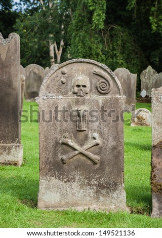 An old gravestone in an English cemetery  - stock photo