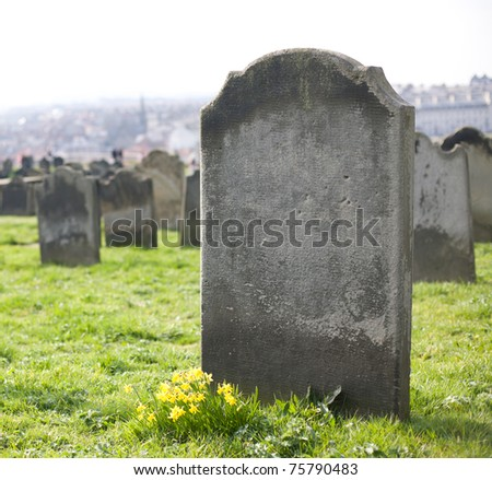 An old gravestone in the cemetery - stock photo