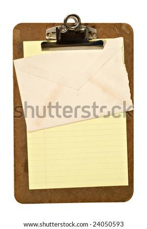 An old grungy clipboard holding yellow paper and an envelope. File has clipping path.