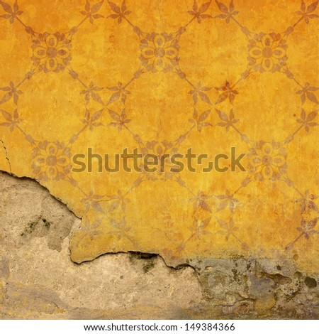 An Old Grungy Stone Wall Background with Wallpaper Pattern - stock photo