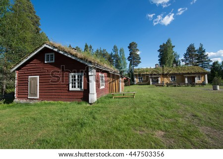 An old historic houses with grassroofs in Elverum, Norway - stock photo