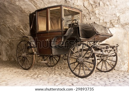 An old horse-drawn carriage - stock photo