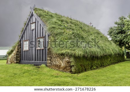 An old Icelandic church with a sod roof - stock photo