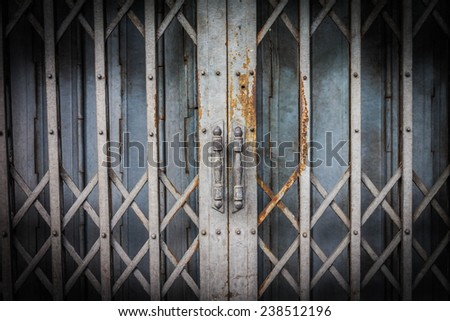 An old iron gate locked - stock photo