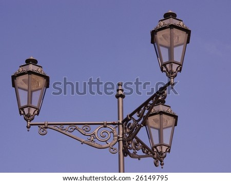 An old lamppost in a ancient city - stock photo
