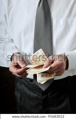 an old man count his money - stock photo