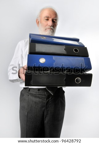 an old man holds many folders - stock photo