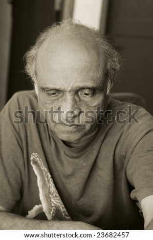 An old man looking very depressed at recession - stock photo