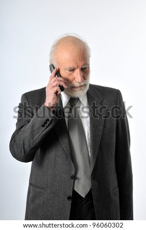 an old man speaking in his phone - stock photo