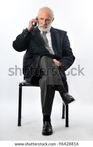 an old man talking in his phone - stock photo