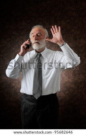 an old man who talking in phone in studio - stock photo
